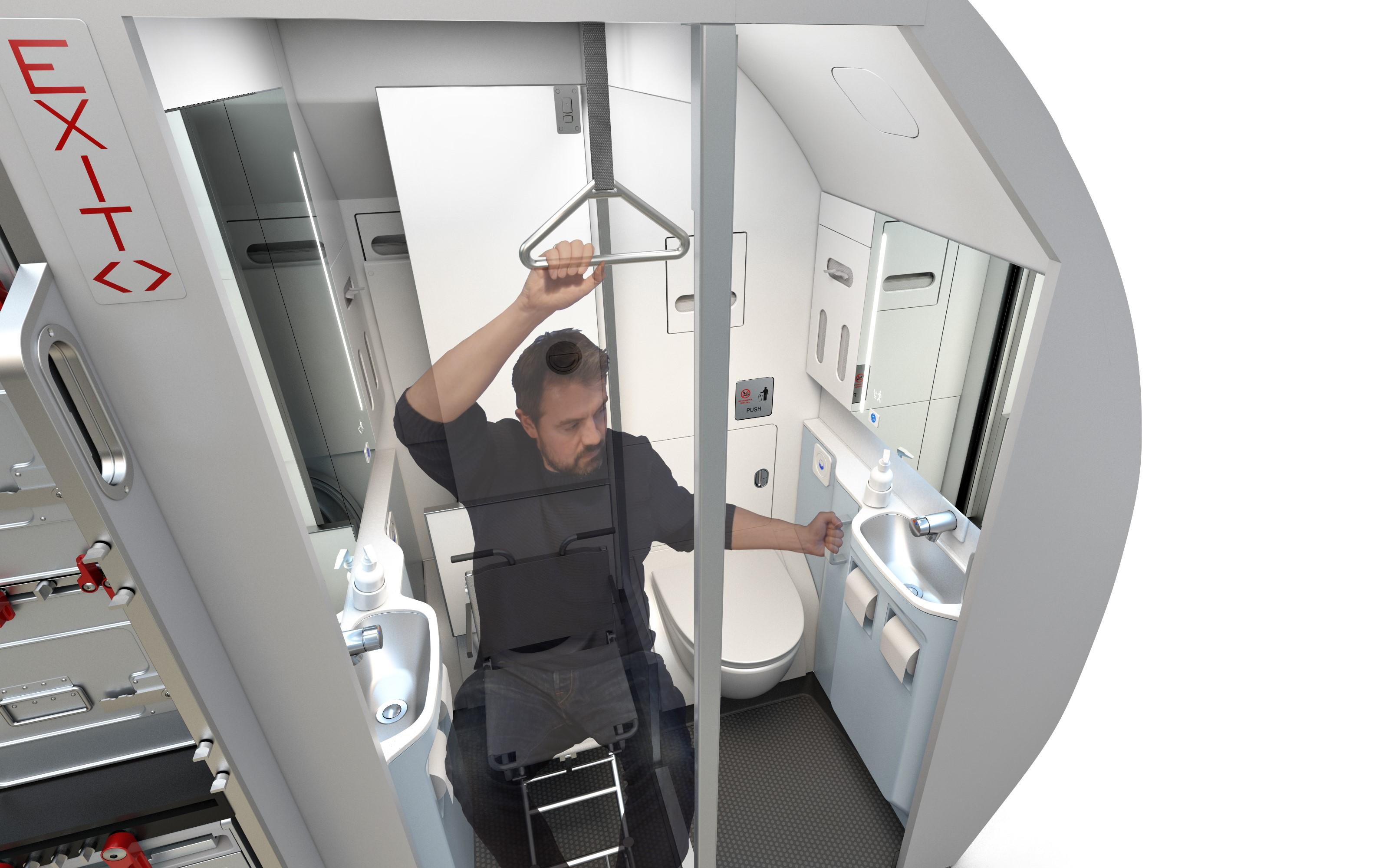 With the help of ceiling and wall handles, wheelchair users can lift themselves to the toilet.
